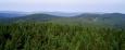 Tady je pohled na zalesněný hřeben směrem ke Kašperku (Ždánov) a Sedlu.