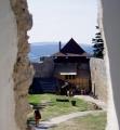 V průběhu dalších let byl hrad ponecháván neustále v zástavě a držitelé se poměrně často střídali. Např. v letech 1411 až 1454 přešel do držení rodu Zmrzlíků ze Svojšína a Orlíka. Otec Petr, královský mincmistr, i jeho stejnojmenný syn patřili mezi přívržence kalicha. Díky jim se Kašperk nikdy nestal terčem pustošivých husitských útoků. Ostatně ani ve své další historii nebyl tento šumavský hrad nikdy dobyt.