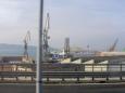 Přístav v Terstu, jímž jsme projížděli na zpáteční cestě, nabízí podívanou na monstrózní jeřáby v přístavu.