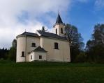V 16. století zde stávala nejprve kaple, která však roku 1739 zchátrala tak, že kníže Josef Adam Schwarzenberg nařídil staviteli A. E. Martinelli, aby zhotovil plány kostela. Stavba byla provedena až po úmrtí Martinelli v letech 1752-54 stavitelem Franzem Fortinim. 22. července 1754 byl kostel slavnostně vysvěcen. Ve věži visel malý zvonek, který byl roku 1763 doplněn o větší zvon. Roku 1797 dostal kostel střechu ve formě jehlanu, byla též odstraněna malá věžička na čelní straně. Od šedesátých let 20. století kostel chátral a vnitřek byl svévolně ničen. V letech 1993-95 byl důkladně opraven a je opravdu krásný. Škoda, že jsme se nemohli podívat i do jeho útrob.