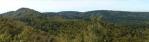 Panorama Špičáku a okolí. Nevypadá moc špičatě, ale je dost skalnatý a cesta na něj je už trochu strmá.