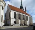 Kostel Nanebevzrtí Panny Marie byl v gotickém slohu postaven ve 2. polovině 14. století a o století později byl opravován a rozšířen o Špulířskou kapli se zajímavou krouženou žebrovou klenbou s figurálními svorníky a plastickými ozdobami se zvířecími motivy.