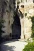 Nedaleko od řeckého divadla je velká jáma zvaná Latomia del Paradiso, vzniklá těžbou vápence. Mimo jiné je zde i proslulé Dionýsovo ucho (Orecchio di Dionisio). V lomu pracovali řečtí otroci po porážce Athén r. 413 př. n. l. Lámáním kamene se vyhloubila jáma 40 m hluboká a dnes je z lomu nádherná zahrada s citrusovníky, akanty a oleandry.Dionýsovo ucho je 60 m dlouhé a 23 m vysoké. V době vlády Dionýsia I. sloužila jako vězení. Říká se, že tyran Dionýsius mohl díky skvělé akustice slyšet, co si vězni povídají ve vyhloubené jeskyni. Něco na tom asi bude, protože každá skupina turistů pod vedením svého průvodce si musí tuto akustiku vyzkoušet.