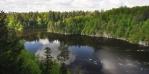 lll. Otava pod Zvíkovským mostem volně plyne a široce obtéká v lesích ukrytý hrad s věží Markomanka ...