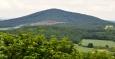 Běleč byla vyhlášená přírodní rezervací. Její území představuje jeden ze zbytků přirozených lesních společenstev tzv. Branžovského hvozdu. Celý zalesněný hřeben s nejvyššími vrcholy prahorních sopek Doubravou (727 m n. m.) a Bělčí (712 m n. m.) je charakteristickým geomorfologickým fenoménem zdejšího území.