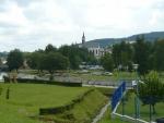 Vyšší Brod, v popředí častý začátek vodácké cesty po Vltavě, v pozadí klášter
