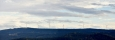 Větrné elektrárny leží na rakouském území za vrcholem Hvězdné (1 012 m n. m.).