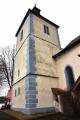 Kostel Narození Panny Marie. Jeho nejstaršími částmi jsou západní věž, západní a jižní stěna lodi, které pocházejí z doby okolo roku 1240. V první třetině 14. století byl postaven dnešní presbytář a zbylé obvodové zdi lodi. Velká přestavba proběhla počátkem 16. století a jejím výsledkem byla severní mohutná věž (na fotce) a asymetrické rozvržení obou částí dvojlodí.