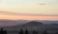 Kněží hora u Katovic je zajímavým kopcem, který skrývá i staré slovanské hradiště, které je jedním z nejdůmyslnějších a nejsložitějších dochovaných raně středověkých opevnění v Čechách a vymezuje plochu o rozloze 8 ha. Na jižní straně, kde svahy hory prudce klesají k Otavě a vytvářejí osmdesáti metrové převýšení, je hradiště opevněno nejslaběji. Nejjednodušší přístup je na severovýchodní straně a proto je zde hradiště chráněno několika liniemi opevnění. Hradiště je členěno na akropoli, která se nalézá na vrcholové plošině hory, a na dvě předhradí. Akropole je opevněna po celém svém obvodu a od západu, severu i východu se na její opevnění napojuje svažité vnitřní předhradí s až 4 m vysokými dvojitými valy s příkopy, jež dosahují délky 433 m a 424 m. K vnitřnímu předhradí se přimyká předhradí vnější, které je chráněno valem s vnějším příkopem v délce 640 m, místy dosahujícím výšky až 5 metrů ode dna příkopu. Původní hlavní vstup do hradiště, v podobě čelní brány se zataženými křídly hradby dovnitř hradiště, je dosud patrný v severní části vnějšího valu. Do samotné akropole byl vstup na západní straně. Opevnění Kněží hory nebylo dosud systematicky prozkoumáno. Podle terénních pozorování se usuzuje na dřevohlinité opevnění roštové konstrukce s čelní, nasucho kladenou kamennou zdí.(http://www.archeolog.cz/lokalita/slovanske-hradiste-knezi-hora/35)