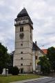 Renesanční věž kostela sv. Vavřince vytváří dominantu města. Je vyzdobena sgrafitovým kvádrováním . Sedmiposchoďová věž je ukázkou severoitalské stavitelské práce. Byla postavena v letech 1586 - 1592 pod vedením stavitelského mistra Francesca Garofa de Bissone.  Vystoupíte-li po 150 točitých schodech na ochoz, naskytne se Vám překrásný výhled na město a okolí.