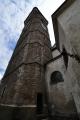 Farní kostel Nanebevzetí Panny Marie musel existovat již na konci 13. století, kdy byla středověká opevněná kruhovitá osada rozšířena o prostorné tržiště na půdoryse protáhlého trojúhelníka směrem k západu a o menší tržiště na východě. Je tedy pravděpodobné, že kostel stál uprostřed původní osady na místě dnešního kostela, jehož základy můžeme klást zhruba do poloviny 14. století (v listině z roku 1359 je uváděn kostel Panny Marie ve Slavonicích). Při severní stěně presbytáře tehdy stála sakristie a před západním průčelím byla kaplanka a věž s průchodem na hřbitov – dnešní průchod Panským domem. Hřbitov se rozkládal kolem kostela a při něm byl zřízen i karner, později zaniklý a věž sloužila zároveň i jako zvonice a snad i jako hláska. Z úzkého ochozu věže se lze porozhlédnout po Slavonicích i jejím okolí.
