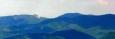 Nedobře lze rozpoznat i Vápeč. Impozantní vrchol, který vynikne především pokud se ocitnete v jeho bezprostřední blízkosti. Hodně velké přiblížení a focení z ruky kvalitě obrázku ubralo na kvalitě, pohled na tuto horu však stojí za uvedení.