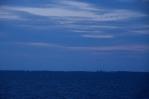 Jedeme trajektem z Puttgardenu do Rødby, břehy Dánska se pomalu blíží.