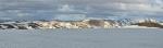 Panorama ze sněhové pláně, po níž klesáme