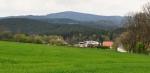 Poluška (919 m n.m.) nad Omlenicemi byl také dnešní možný cíl. Tento vrchol spolu se sousední Kraví horou v přírodním parku Poluška si necháme napříště.
