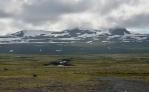 Cestou na jih stavíme na vyhlídkovém odpočívadle pod horou Tröllakirkja schovávající se v mracích