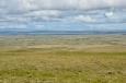 Holá krajina pod Ring road, která asi není využívána ani jako pastviny.