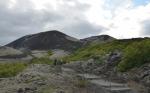 Sopka nad Bifröstem s lávovým polem v popředí. Škoda, že už se blíží večer a my se chceme dostat na jih.