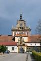 Impozantní barokní klášter podle návrhu A. Spezzy založil v roce 1627 Albrecht z Valdštejna. V roce 1782 byl však Josefem II. zrušen. Poté zde bylo vojenské skladiště, sýpky nebo kanceláře. Po odchodu úředníků areál chátral. Uplatnění se našlo v letech 1855-57, kdy byl upraven vídeňským architektem Wehrenfenningem na trestnici, která se zde nachází dodnes a je jedním z nejpřísnějších vězení v zemi. (Mapy.cz)