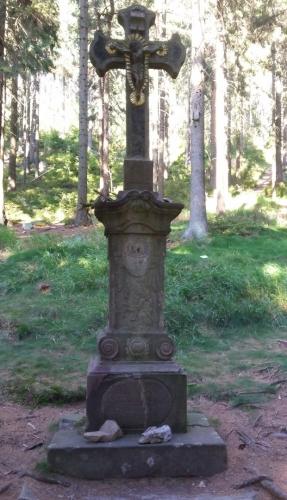 Hutterův kříž.